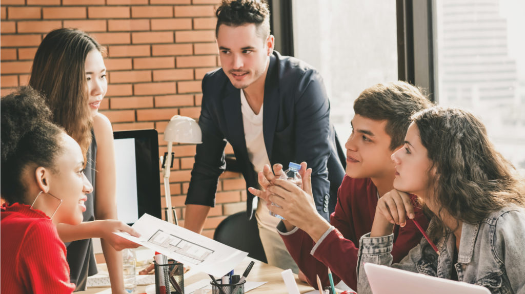 Millennial generation at work - coworking and open office floor plans